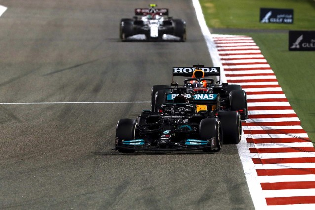 Lewis Hamlton getting chased down by Max Verstappen in the closing stages ofh the Bahrain GP